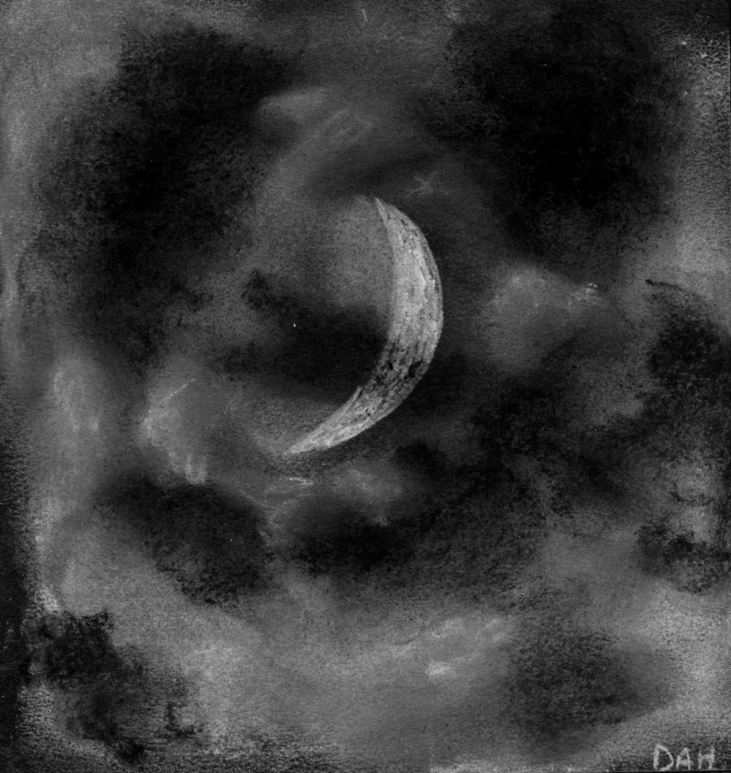 The six day old crescent Moon through the clouds - April 16, 2013